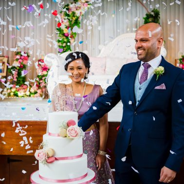 Cake cut at wedding in hertfordshire- olivinestudios